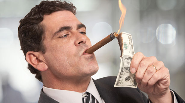 Rich-Businessman-Lighting-Cigar-With-100-Dollar-Bill-Shutterstock